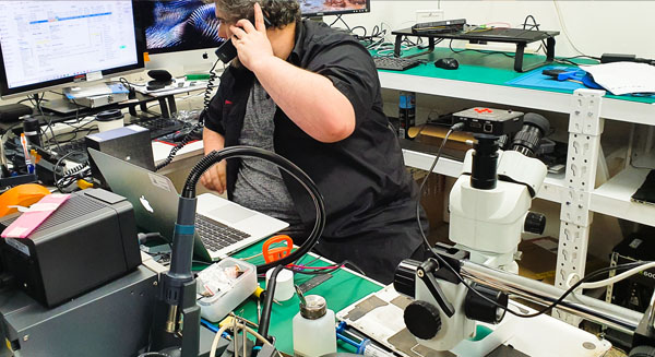 Technician answering helpdesk phone call