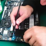 Internal Laptop Battery Being Replaced by Technician