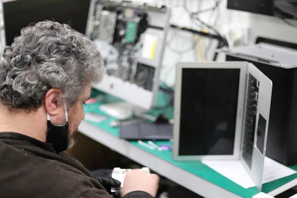Technician Servicing Laptop